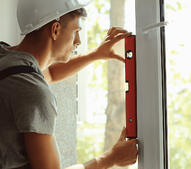What Makes New Homes More Efficient? Installing Windows image